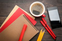 Office stationery, cup of coffee. And phone on table stock images