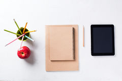 Office Stationery Objects Pencil Apple Notebook. School and Office Stationery Objects Pencil Apple Notebook Apple on Grey Table Background Top View Flat Lay Stock Images