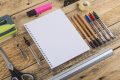 Office Stationery. Office and school stationery supplies arranged on a wooden desk Stock Photo