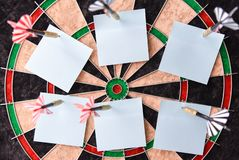 Office stickers on the dart board, close-up, copy space royalty free stock image