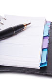 Office still-life. (pen and planner) on white background (isolated Stock Images