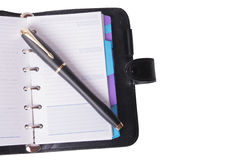 Office still-life. (pen and planner) on white background (isolated Royalty Free Stock Image