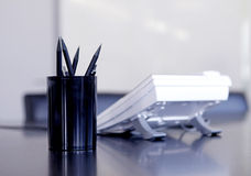Office still life. With pencils and telephone on desk Stock Images