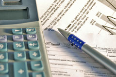 Office still life close-up. Close-up of calculator, pen and rule on paper table with graf.Graph. Business.Tax return form Stock Images