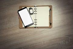Office still-life and smartphone. Office still-life and smartphone Top view. Toned photo Stock Photo