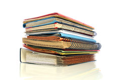 Office Still Life. Stack of office folders and sketchbooks on white background Stock Images