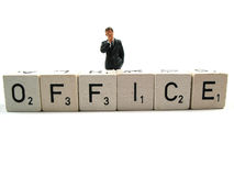 Office straight. A manager standing behind the word office royalty free stock image