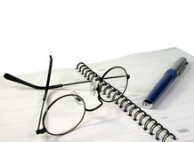 Office stuff. Still life with notebook,spectacles and ball-pen Royalty Free Stock Image