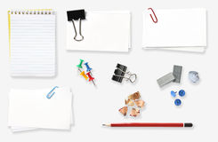 Office Stuff. Variety of office stationery, isolated on white.  Includes spiral notebook, blank labels, bulldog clip, push pins, staples, pencil and pencil Stock Image