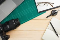 Office stuff and gadgets on wooden desk. Top view of office stuff and gadgets on wooden desk with graphic designer equipment. flat lay style stock photos