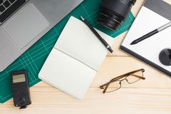 Office stuff and gadgets on wooden desk. Top view of office stuff and gadgets on wooden desk with graphic designer equipment. flat lay style royalty free stock photo