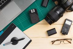 Office stuff and gadgets on wooden desk. Top view of office stuff and gadgets on wooden desk with graphic designer equipment. flat lay style stock images