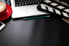 Office stuff with Movie clapper laptop and coffee cup pen notepad royalty free stock photos