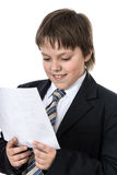 Teenage boy reading letter Royalty Free Stock Photos