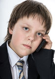 Teenage boy with mobile phone. Office style dressed young boy isolated on white Stock Photo