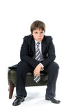 Young boy sitting on chair Royalty Free Stock Images