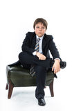 Young boy sitting on chair Stock Image