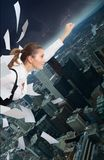 Office superman. Woman flying in downtown and fighting with paper work stock photo