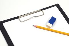 Office supplies. Pencil, eraser and clipboard Royalty Free Stock Photography