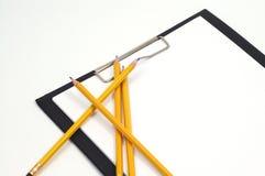 Office supplies. Pencils on clipboard stock photos