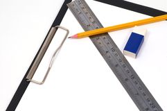 Office supplies. Pencil, eraser, and clipboard stock image