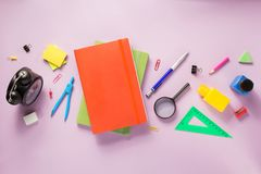 Office supplies at abstract paper background royalty free stock image