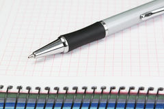 Office supplies. Ballpoint pen and notebook. Stock Photos
