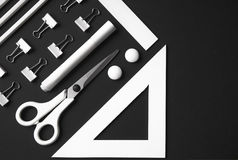 Office supplies on the black background table Royalty Free Stock Photography