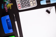 Office supplies on black desk Royalty Free Stock Photo