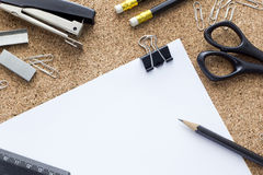 Office supplies. Black lie on cork board Royalty Free Stock Image