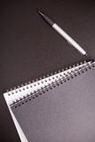 Office supplies on black table Stock Images