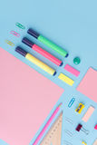 Office supplies on the blue background table royalty free stock photo
