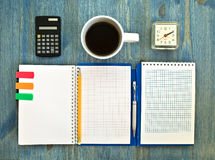 Office supplies and checked notebook Stock Photos