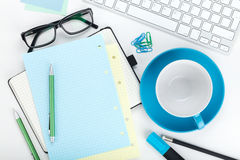 Office supplies, computed keyboard and coffee cup Stock Photography