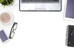 Office supplies with computer notebook on white desk Royalty Free Stock Images