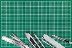 Office supplies on cutting mat - cutters, scissors, mechanical p Stock Images