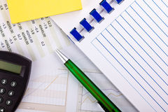 Office supplies and financial document with charts Stock Photo