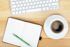 Office supplies, gadgets and coffee cup Stock Image
