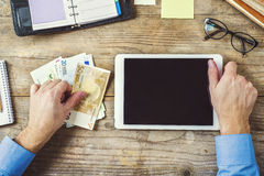 Office supplies, gadgets and money on wooden table photos libres de droits