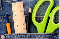 Office supplies on jeans pocket Stock Image