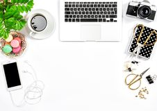 Office supplies and laptop Feminine flat lay. Office supplies and laptop. Feminine flat lay. Coffee and macaroon cookies Stock Photography
