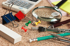 Office supplies in a mess on the table. Stationery in a mess on the table Stock Images