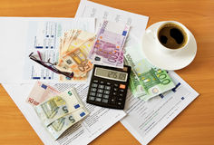 Office supplies with money and cup of coffee Royalty Free Stock Image