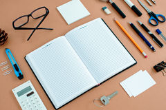 Office Supplies Neatly Organized Around Notebook Stock Photos