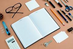 Office Supplies Neatly Organized Around Notebook Stock Photos