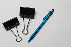 Office supplies: pen and clips royalty free stock images