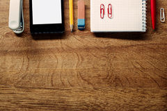 Office Supplies and Phone on Table at Top Edge Stock Images