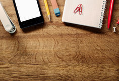 Office Supplies and Phone on Table at Top Edge Stock Photos