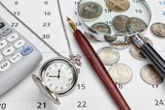 Office supplies and pocket watches. Stock Photos