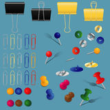 Office supplies set. A set of office supplies, paper clips, binders and pins, different colors and forms Stock Photos